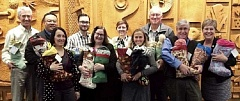 SUBMITTED PHOTO - City of Lake Oswego staff have filled dozens of stockings to donate to families in need this holiday season.