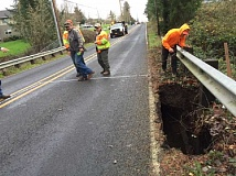 TIMES PHOTO: JAIME VALDEZ - A sinkhole opened along Southwest Beef Bend Road on Tuesday. Officials say the road will be closed for at least a week.