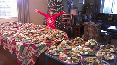 CONTRIBUTED PHOTO - Kendall Raff, 10, shows off the 50 plates of cookies she helped her family bake this year as part of their holiday tradition. The day-long production yielded 36 varieties of sweet treats that were plated and delivered to friends, family members and co-workers.