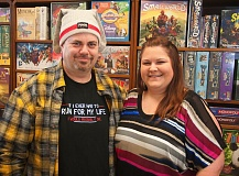 OUTLOOK PHOTO: SHANNON O. WELLS - Alan and Becky Schmid are all smiles after opening Goin Gaming, a Troutdale store that sells board and card games as well as providing a gathering place for gamers to play and compete in their favorite parlor pursuits.