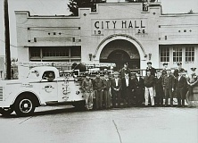 SUBMITTED PHOTO - Lake Oswego firefighters pose in front of City Hall circa 1946. That's Gene Vinson seated in the fire engine. In the back row (from left): Earl Hughes, Bill Daniels, Verle Gump and Bill Ravenaugh. In the front row (from left): Jack Baker, George Rogers Jr., Hueston Reynolds, Joe Nemec, Arthur Red McVey, Neil Cooper, Dick Goodrich, Al Bean, Bill Asplundh, L.S. McKay and Bill Knowles.