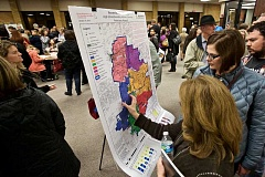 TIMES PHOTO: JAIME VALDEZ - Parents look over the latest proposal to shift high school boundaries across the Beaverton School District during a Jan. 21 open house at Five Oaks Middle School.