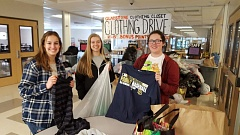 PHOTO COURTESY: LESLIE ROBINETTE - Gladstone High seniors Kat Kerr, Noelle Basham and December Mason sort items donated during the school clothing drive.
