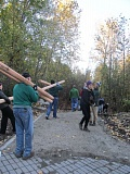 ELLEN SPITALERI - Milwaukie resident Dick Shook, foreground, carries large wooden poles that will mark off the boundaries of trails at Spring Park Natural Area.