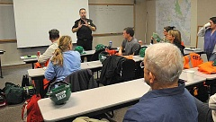 REVIEW PHOTO: VERN UYETAKE - Fire Marshal Gert Zoutendijk leads a debriefing session at the end of a recent disaster simulation, which is part of the city's Community Emergency Response Team training. More than 1,500 community members have gone through CERT training in Lake Oswego.