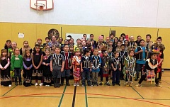 COURTESY PHOTO - Students at Willamina Elementary School don Native American dress as part of a special fourth-grade curriculum developed by the Confederated Tribes of Grand Ronde. The tribes would like to bring the curriculum to Banks as well, as part of a partnership that would allow the school district to keep its Braves mascot.