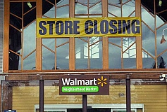 REVIEW PHOTO: VERN UYETAKE - Large banners herald the Jan. 28 closing of the Walmart Neighborhood Market on Jean Way. Many of the 64 employees will be relocated to other Walmart stores, the company said.