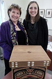 REVIEW PHOTO: CLIFF NEWELL - Oswego Heritage Council President Candee Jones (left) and Executive Director Katie Henry hope to display more items like this beautiful pine box made by Native Americans.