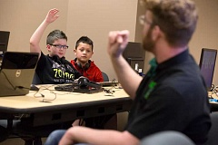 TIMES PHOTO: JONATHAN HOUSE - Aidan Shafer asks a question during a learning module at Fidgets2Widgets.