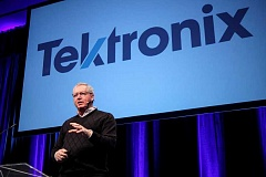 SUBMITTED PHOTO - Tektronix President Pat Byrne unveiled the company's new logo at a recent employee meeting.