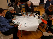 REVIEW PHOTO: ANTHONY MACUK - Community members pore over maps and discuss design options for the new segment of Iron Mountain Park at a city-hosted charrette on Saturday.