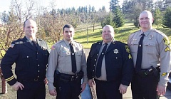 SUBMITTED PHOTO - From left, Jefferson County Sheriff's Office Capt. Marc Heckathorn, deputy Tyler Anderson, Sgt. Jason Erickson, and Cpl. Ryan Grote attended Anderson's graduation ceremony Jan. 22, at the Oregon Department of Public Safety Standards and Training in Salem.