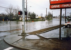 CITY OF BEAVERTON PHOTO - The intersection of Southwest Cedar Hills and Hall boulevards turned into a lake when Beaverton Creek overflowed its banks during torrential rains that struck the region in early February 1996.