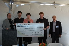 PHOTO BY KATHY SCHAUB - Clackamas High School was the surprise recipient of a $1,000 at Monday's groundbreaking of the Happy Valley Crossroads shopping complex, which Fred Meyer said would be the first of many to the community. Pictured from left are Jeff Betts, CHS band director; band member Elliott Howard; Melinda Merrill, Fred Meyers manager of community affairs; band member Christian Kerr; and Barry Cain, president of Gramor Development.