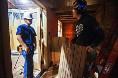 OUTLOOK PHOTO: JOSH KULLA - ACE Academy student Angel and instructor Katie Hughes discuss flooring installation Wednesday inside one of two tiny houses students currently are building.