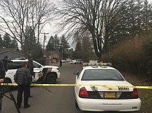 Deputies investigate a homicide on Southwest Cedarcrest Street in Metzger.