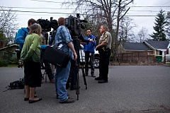 Sgt. Bob Ray speaks with reporters on Wednesday following a homicide on Southwest Cedarcrest Street in Metzger
