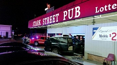 PORTLAND POLICE BUEAU - A hit and run driver caused this crash into the Stark Street Pub, located at 14270 Southeast Stark Street.