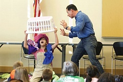 TIMES PHOTO: JAIME VALDEZ - Actors Michaela Warren and Rich Cohn-Lee, who play the parts of Trixie and Dad in 'Knuffle Bunny: A Cautionary Musical,' perform in a preview performance for families at the Beaverton City Library.