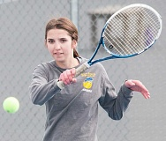 LON AUSTIN/CENTRAL OREGONIAN - Kadence Kee plays a forehand shot against Molalla's No. 2 doubles team of Rachel Norgren and Jess Donaldson. Kee and her partner, Grace Harper, lost the match 6-3, 6-4.