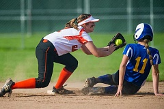 PHOTO COURTESY OF JOHN LARIVIERE CLACKAMAS REVIEW - Mckuenzie McCormick slides safely under the tag of Gladstone shortstop Katt Kerr (left) to steal second base in the top of the second inning of the Cowgirls' Friday afternoon loss to the Gladiators.