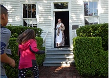 BARBARA SHERMAN - Miss Ellen, the Buttevlle Schoolhouse schoolmarm, welcomes Deer Creek fourth-graders into the 157-year-old structure for a lesson in learning in a one-room school.