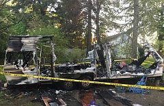 SUBMITTED PHOTO - An Aloha woman was arrested Tuesday morning after she allegedly set fire to a travel trailer in Aloha where she lived with her family.
