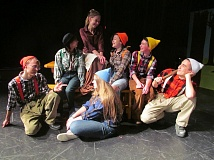 PHOTO BY DICK TRTEK - Clockwise, from top, Snow White (Lindsey Trost) gazes fondly at members of her dwarf friends, including, Renada Villanti, Duncan Harris, Daniel Toh, Alana Zoesch, Kyle Obermire and Nikki Alexander.
