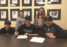 SUBMITTED PHOTO - Tyler Tacla poses for a photo with his family during his letter of intent signing.
