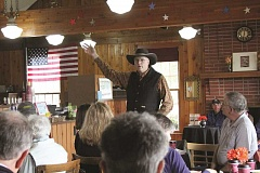 LINDSAY KEEFER - Tom Swearingen, a poet from Tualatin who is active in St. Paul Rodeo, shares one of his poems with a group of St. Paul residents at Banker's Cup on Friday. The poetry recitation was part of a celebration of William Shakespeare's birthday.