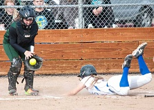 LON AUSTIN/CENTRAL OREGONIAN - Caitlyn Elliott slides safely into home during the Cowgirls' 10-0 win over Estacada on Friday. The win moves the Cowgirls into a tie for second place in the Tri-Valley League.