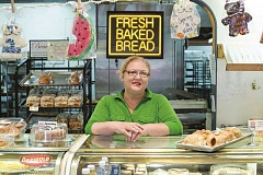 TIMES FILE PHOTO - Carrie Ann Schubert, shown here when the Beaverton Bakery was celebrating its 90th anniversary last year, recently was honored by the White House for giving people a second chance after release from prison.