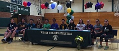 COURTESY: WILSON HIGH - Wilson Trojans athletes for a letter-of-intent signing day ceremony on Monday.