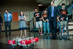 TIMES PHOTO: DIEGO DIAZ - Sen. Ron Wyden checks out The Spanish Inquisition, the Beavertronics' team robot, during one of his stops to check out Beaverton High School's science-related curriculum on Tuesday.