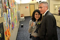 REVIEW PHOTO: VERN UYETAKE - Marisa Steinberg enjoys looking at the art with her dad, Lance.