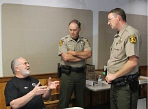 PHOTO CONTRIBUTED BY JAMES SAVAGE - Sheriff's Academy participant Dick Prins talks with Sheriff John Gautney (middle) and Undersheriff James Savage during the academy, which was held Feb. 3 to April 27.