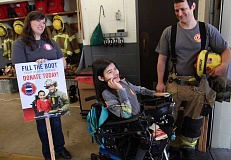TIMES PHOTO: JAIME VALDEZ - Jordyn Valdez, 13, chats with firefighter Trevor Nowak and Elizabeth Squires of the Muscular Dystrophy Association at the kick-off event for next week's 'Fill the Boot' fundraising campaign.