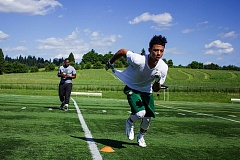 PAMPLIN MEDIA GROUP: ANDREW BANTLY - Jaydon Grant works out at Hazelia Field in Lake Oswego with trainer Houston Lillard. Grant will play football at Oregon State next year.