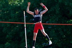 TRIBUNE PHOTO: JONATHAN HOUSE - Lincoln High sophomore Lukas Weinbach wins the PIL district meet pole vault, clearing 13 feet, 6 inches at Lincoln on Wednesday. Wilson sophomore Alex White was second at 13-0.