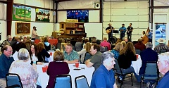 CONTRIBUTED PHOTO - Fair leaders from throughout Oregon enjoy some music during a meal in Crook County Fairgrounds' indoor arena. The fairgrounds drew about 75 people for the Oregon Fair Association's Spring Conference.