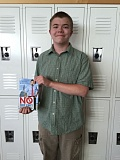 Tim Withrow is pictured with John Stossel's 'No They Can't' book.