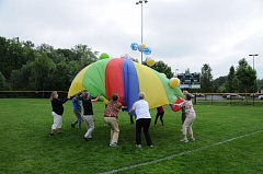SUBMITTED PHOTO - Participants in last year's Field Day in the Park struggle to keep beach balls bouncing on top of a parachute; this year's parachute game will take place in the seating area, so anyone, even those in wheelchairs can take part.