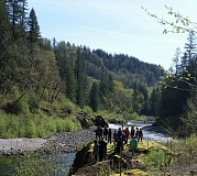 BRIAN MAPES - At the Marmot Dam Site, Located in Bull Run, CWA students and faculty look out at the Sandy River from one of the ledges along the riverbank.