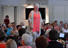 SPOKESMAN PHOTO: JAKE BARTMAN - Mary Ann Storey models styles from Bridgeport Village's Soft Surroundings at the fashion show May 11. Storey moved to Charbonneau with her husband in 2013 to be closer to family, including her four grandchildren and two great-grandchildren. She enjoys knitting, plays golf and is secretary of her homeowners association.