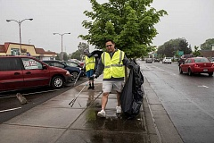 NEWS-TIMES PHOTO: CHASE ALLGOOD - Luis Hernandez (front) and Jose Valdez volunteered to clean up litter in front of the old Grande Foods on Adair Street during Take Care of Cornelius Day Saturday, May 14.