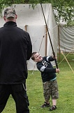 NEWS-TIMES PHOTOS: CHASE ALLGOOD - Sponsored by The Barony of Dragons Mist, a Washington County group dedicated to re-creating the European history of the Middle Ages and Renaissance, the annual Faire in the Grove took place on the front lawn at McMenamin's Grand Lodge last weekend. Here, Cooper Hood, 5, practices sword fighting with his father, Eli Hood, during a class put on by Academia Duellatoria.