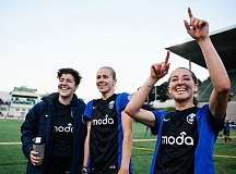 COURTESY: SEATTLE REIGN - Danielle Foxhoven (right) points to fans with then-Seattle teammates Keelin Winters (left) and Beverly Yanez.