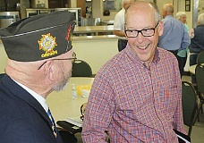 HOLLY M. GILL - U.S. Rep. Greg Walden, right, visits with John Wrinkle, of Redmond, following a town hall meeting May 14, at the Jefferson County Senior Center.