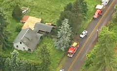 COURTESY PHOTO: KOIN 6 NEWS - A smoky fire killed two men Thursday, May 19, inside a house on South Leabo Road in Molalla.