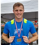 TRIBUNE PHOTO: CHRISTOPHER KEIZUR - Harrison Schrage, Grant High senior, wears the fourth state long jump first-place medal he has won in his career.